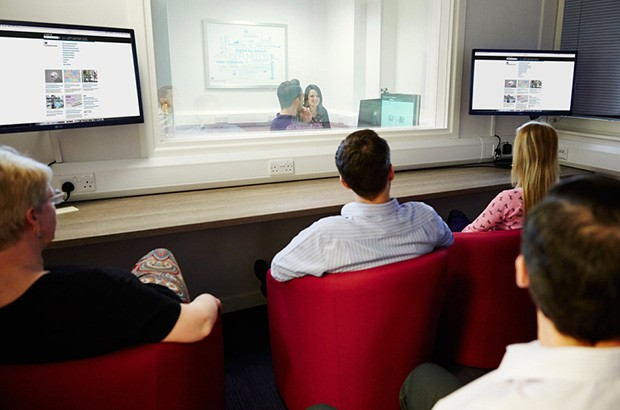 Photo of Companies House usability lab with users and the team