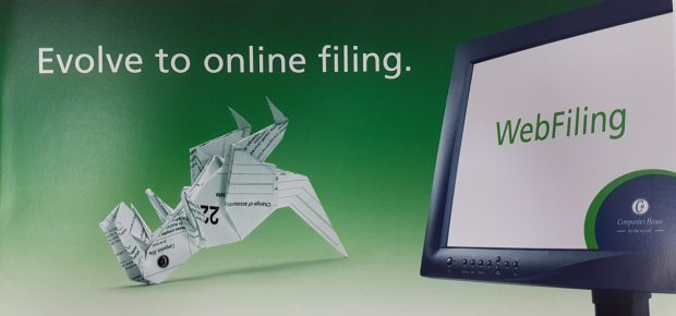Picture of an ad for WebFiling showing a paper dinosaur next to a computer