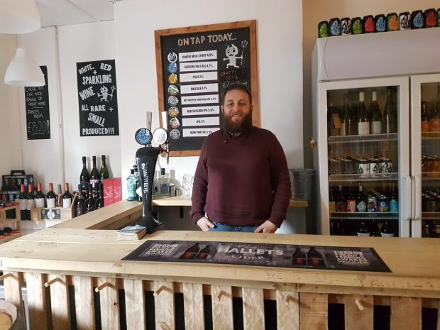 Rhys in the The shop front of the bar