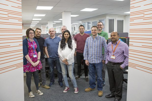 The team standing up and smiling in the Companies House Cardiff office.