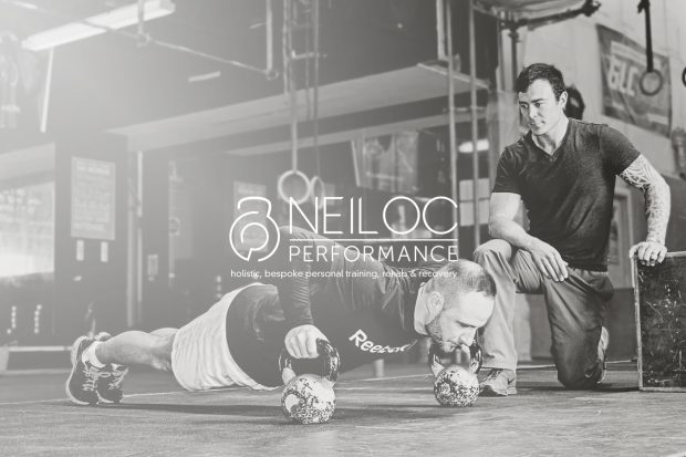 Image of Neil training a client doing push ups.