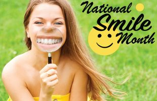 Girl smiling with magnifying glass to her mouth.