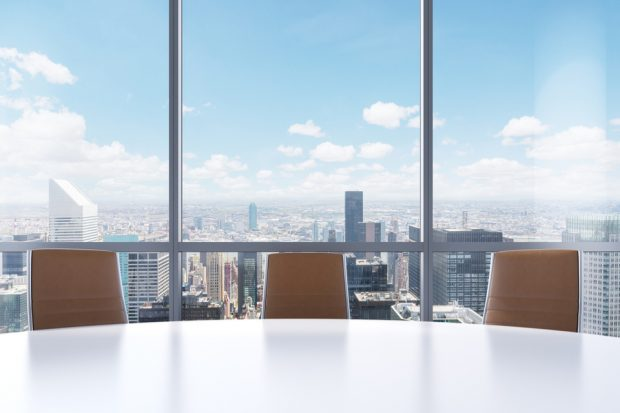 Boardroom in a skyscraper with city view.