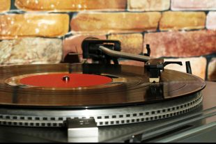 Turntable playing a vinyl record.