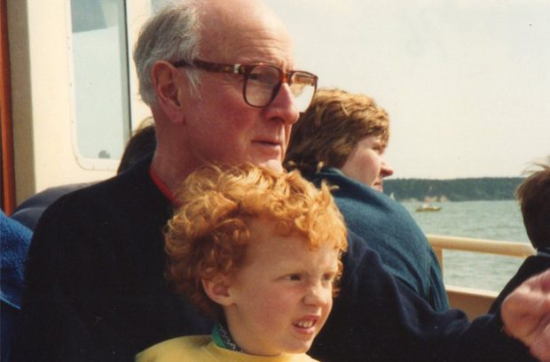 Ben Atkinson-Willes as a young child on a boat with his grandfather.