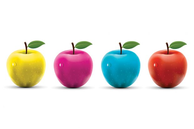 Four apples in the colours of the Sgt Pepper's outfits lined up horizontally against a white background.