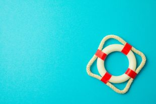 A red and white lifesaver against a blue background.