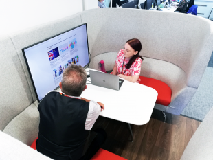 Two Companies House colleagues sat in a pod looking at the screen.