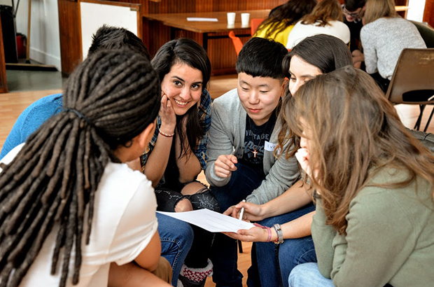A group of young people talking at a volunteering event