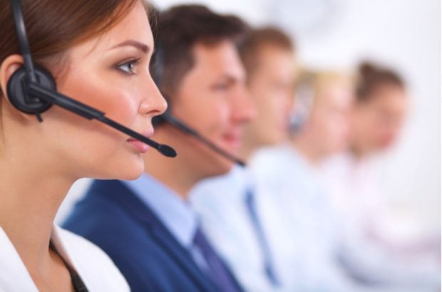 Colleagues taking calls in a call centre.