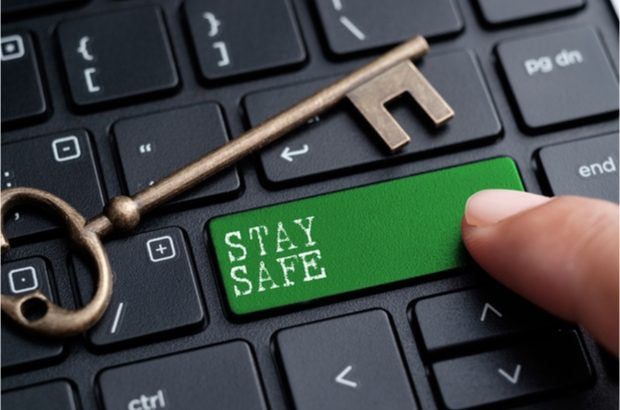 Key on laptop staying 'Stay Safe'  Protecting your company from unauthorised filings shutterstock stay safe 620x410