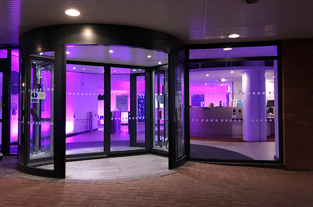 The entrance of Companies House, Cardiff lit up purple in support of #PurpleLightUp