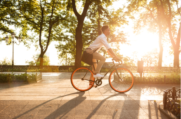 A man riding a bike.   What we're doing to tackle climate change shutterstock 701564650