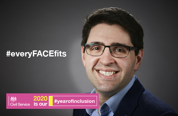 A headshot of a man wearing spectacles and smiling. Next to him, there is text that reads #everyFACEfits, and '2020 is our #yearofinclusion'