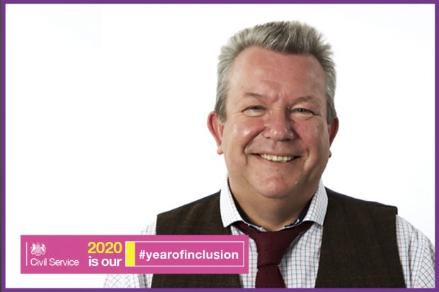A man smiling at the camera, next to the words 'Civil Service, 2020 is our #yearofinclusion'